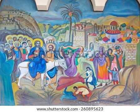 BETHLEHEM, ISRAEL - MARCH 6, 2015: The modern fresco of Palm Sunday from 20.cent. in Syrian orthodox church by artist K. Veniadis (1987). - stock photo