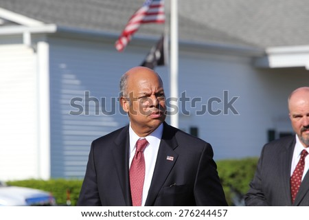 BETHPAGE, LONG ISLAND - MAY 7 2015: a formal viewing for slain NYPD officer Brian Moore, attended by thousands of police officers from North America. Homeland Security director Jeh Charles Johnson - stock photo