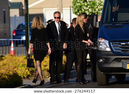 BETHPAGE, LONG ISLAND - MAY 7 2015: a formal viewing for slain NYPD officer Brian Moore, attended by thousands of police officers from North America. Brian Moore family arrives at funeral home - stock photo