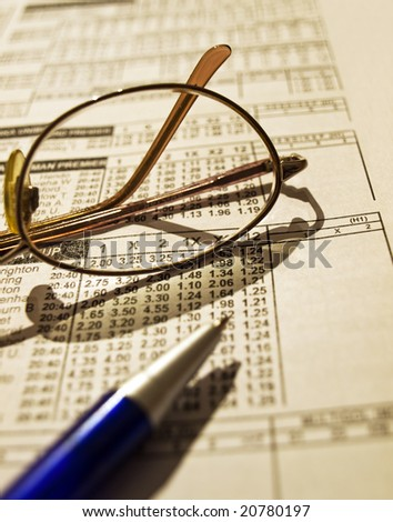 Betting odds list with an appropriate tools. - stock photo