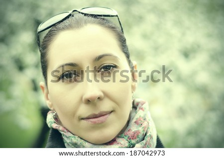 Beutiful brunette woman outdoor. Vintage photo. - stock photo