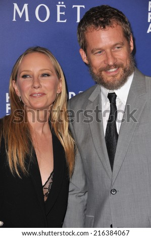BEVERLY HILLS, CA - AUGUST 14, 2014: Anne Heche & boyfriend James Tupper at the Hollywood Foreign Press Association's annual Grants Banquet at the Beverly Hilton Hotel.  - stock photo