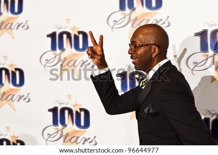 BEVERLY HILLS, CA - FEB 26: Former NBA basketball player John Salley arrives for the 22nd Annual Night Of 100 Stars event held at The Beverly Hills Hotel on Feb. 26, 2012 in Beverly Hills, CA. - stock photo