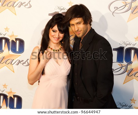 BEVERLY HILLS, CA - FEB. 26: VH1 personality Vikki Lizzi (L) arrives for Norby Walters' 22nd Annual Night Of 100 Stars event held at The Beverly Hills Hotel on Feb. 26, 2012 in Beverly Hills, CA, - stock photo