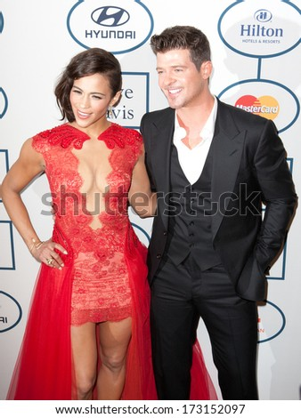 BEVERLY HILLS, CA. - JANUARY 25: Paula Patton & Robin Thicke arrive at the Clive Davis & The Recording Academy annual Pre-GRAMMY Gala on January 25th 2014 at the Beverly Hilton in Beverly Hills. - stock photo