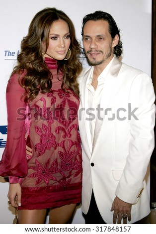 BEVERLY HILLS, CA - NOVEMBER 20, 2006: Jennifer Lopez and Marc Anthony at the 2006 Los Angeles Free Clinic Annual Gala held at the Beverly Hilton Hotel in Beverly Hills, USA on November 20, 2006. - stock photo