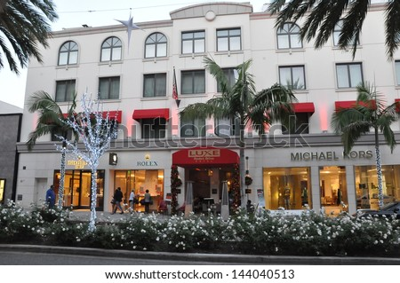 BEVERLY HILLS, CALIFORNIA - DECEMBER 7: Michael Kors and other stores at Rodeo Drive as seen on December 7, 2012 in Beverly Hills, California. There are more than 100 world-renowned boutiques here. - stock photo