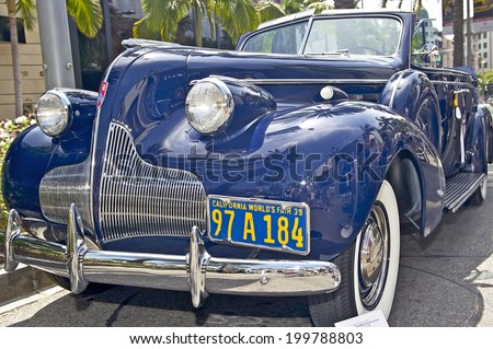 BEVERLY HILLS, CALIFORNIA - JUNE 15, 2014: 1939 Buick Roadmaster Convertible Sedan owned by John and Leslie Milliken  at the Rodeo Drive Concours D'Elegance on  June 15, 2014 Beverly Hills, California, USA. - stock photo