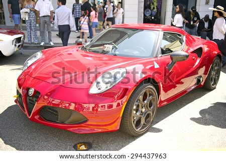 BEVERLY HILLS, CALIFORNIA - JUNE 21, 2015: New Alpha Romeo 4C coupe on display at the Rodeo Drive Concours D'Elegance on June 21, 2015 Beverly Hills, California, USA - stock photo