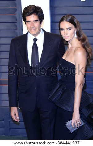 BEVERLY HILLS - FEB 28: David Copperfield, Chloe Gosselin at the 2016 Vanity Fair Oscar Party on February 28, 2016 in Beverly Hills, California - stock photo