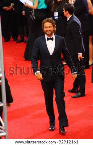 BEVERLY HILLS - JANUARY 15: Actor Gerard Butler arriving to the Beverly Hilton Hotel for the 69th annual Golden Globe Awards ceremony January 15, 2012 Beverly Hills, CA. - stock photo