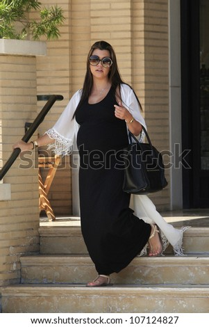 BEVERLY HILLS - JUL 5: Kourtney Kardashian out shopping on July 5, 2012 in Beverly Hills , California - stock photo