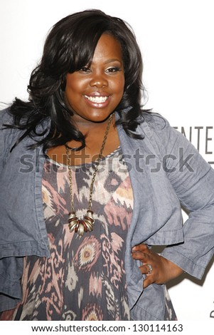 BEVERLY HILLS - MAR 16:  Amber Riley arriving at the 2011 PaleyFest honoring 'Glee' held at the Saban Theater in Beverly Hills on March 16, 2010. - stock photo