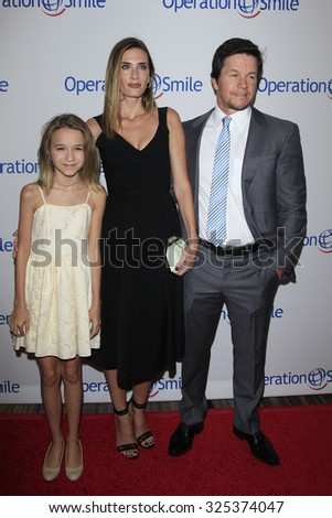 BEVERLY HILLS - OCT 2: Ella Rae Wahlberg, Rhea Durham, Mark Wahlberg at the Operation Smile's 2015 Smile Gala  on October 2, 2015 at the Beverly Wilshire Four Seasons Hotel in Beverly Hills, CA. - stock photo
