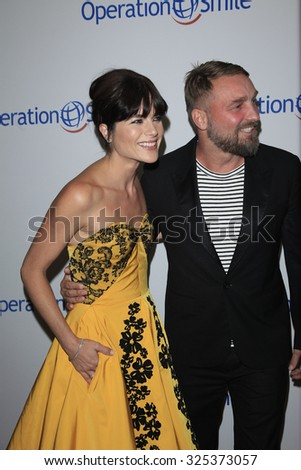 BEVERLY HILLS - OCT 2: Selma Blair, Brian Bowen Smith at the Operation Smile's 2015 Smile Gala  on October 2, 2015 at the Beverly Wilshire Four Seasons Hotel in Beverly Hills, CA. - stock photo