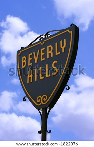 Beverly Hills sign in Hollywood, Los Angeles against a blue cloudy sky - stock photo