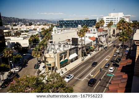 BEVERLY HILLS, USA - AUGUST 7: View of Rodeo Drive during sunny day on August 7, 2012 in Beverly Hills. Rodeo Drive is a shopping district famous for designer label and haute couture fashion - stock photo