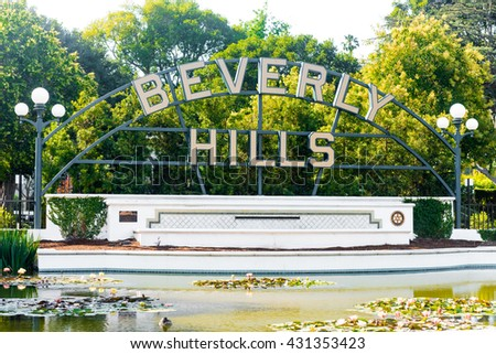 BEVERLY HILLS, USA - MAY 30: Beverly Gardens Park and the Beverly Hills sign, Beverly Hills, CA - stock photo