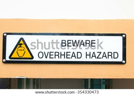 Beware overhead sign in condominium - stock photo