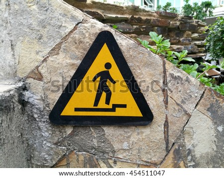 Beware Your Step Sign - stock photo