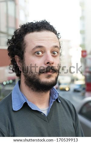 Bewildered young man - stock photo