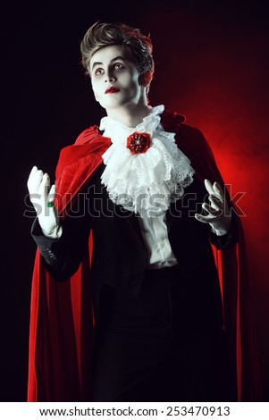 Bewitching handsome male vampire. Halloween. Dracula costume. - stock photo