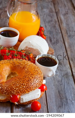 Beygale, tzfat cheese, ripe cherry tomato, coffee and fresh orange juice - traditional israelian breakfast. Selective focus. Copy space background. - stock photo