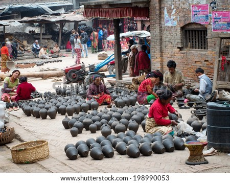 BHAKTAPUR, NEPAL - APR 5: Unidentified Nepalese people working in the her pottery workshop, Apr 5, 2014 in Bhaktapur, Nepal.   - stock photo