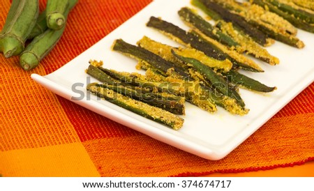 Bhendi fodi is a crunchy, crispy and very delicious stir fry dish and this can be served as an appetizer, evening, snack or with rice and dal.  - stock photo