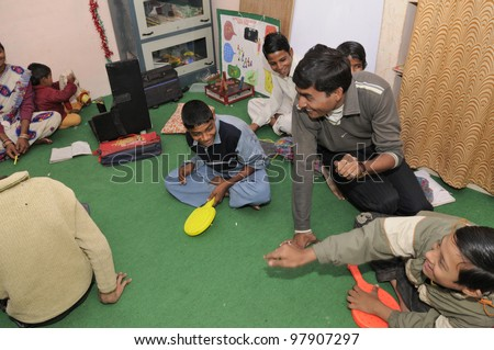 BHOPAL- DECEMBER 7:  New generation victims of the Bhopal gas disaster -most of them suffering from cerebral palsy playing in a rehabilitation clinic in Bhopal - India on December 7, 2010. - stock photo