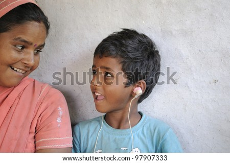 BHOPAL- NOVEMBER 14: 7 years old Lakhan who is deaf from his birth due to alleged chemical contamination to his mother before his birth sharing a laugh in Bhopal - India on November 14, 2010. - stock photo