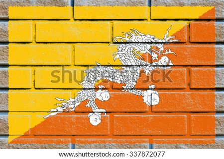 Bhutan flag painted on old brick wall texture background - stock photo