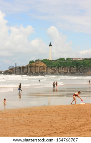 Biarritz beach with a lighthouse on the background, Pays Basque, France. - stock photo