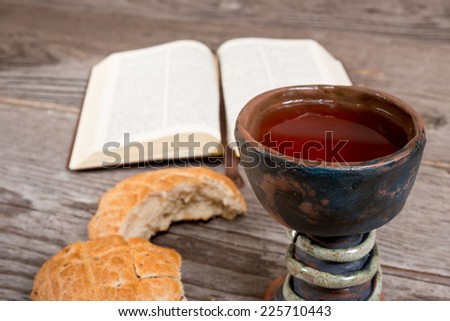 bible and chalice of wine - stock photo