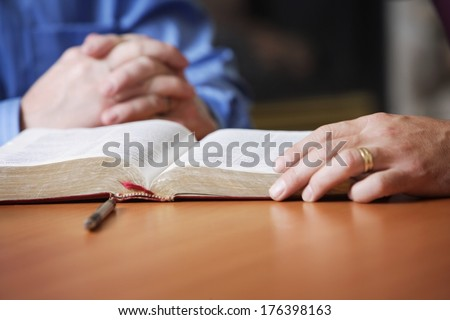 Bible And Praying Hands - stock photo
