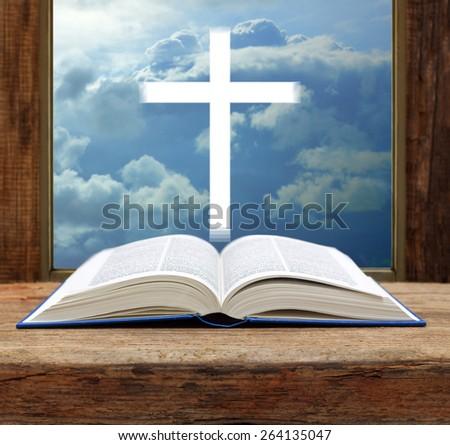 Bible christian cross stormy sky view window open wood - stock photo