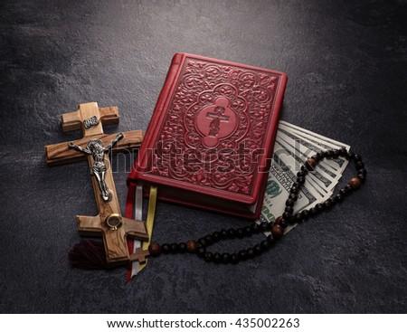 bible, cross and money - stock photo