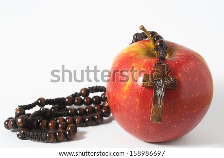 Bible Eva's Sin Red Apple over a White Background - stock photo