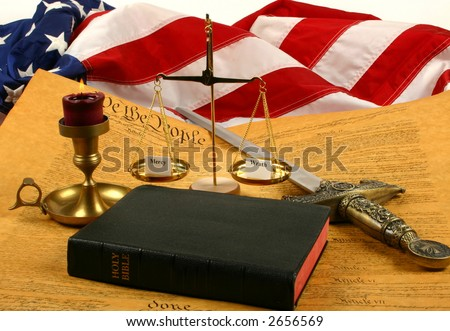 """Bible, Flag of the USA, Constitution, Candle, Sword and Balance with """"Wrath"""" and """"Mercy"""" - stock photo"""