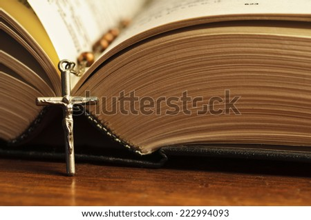 Bible with rosary. Closeup with shallow DOF. - stock photo