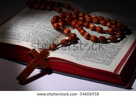 Bible written in cyrillic letters with christian rosary and cross - stock photo