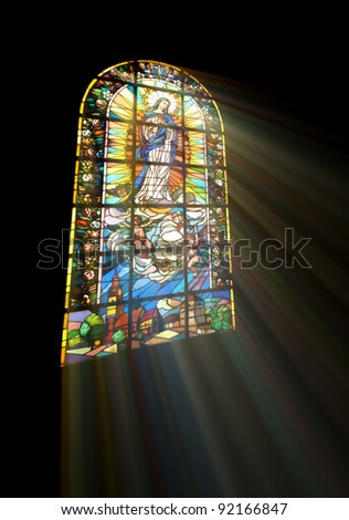 Biblical stained glass with rays of light shining through - stock photo