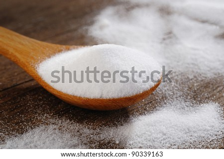 Bicarbonate in a wooden spoon - stock photo