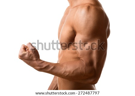 Biceps and pecs muscle of a young athletic man - stock photo