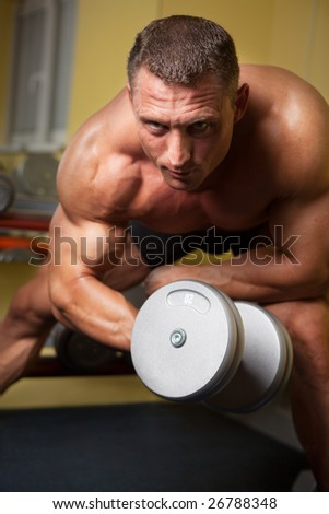 Biceps shot of a strong handsome man - stock photo