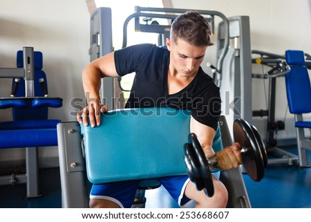 Biceps workout on smit`h bench. - stock photo