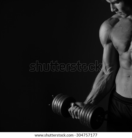 Biceps Workout Sport Background. Closeup of muscular man hands holding a weights. Black and white studio shot on black background. - stock photo