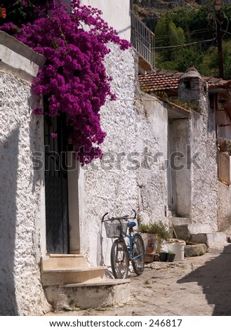 Bicycle and Bougainvillea, Fethiye, Turkey - stock photo