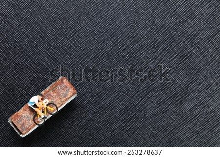 Bicycle brake shoe and figure cycling action model represent the bicycle part and cycling activity concept related idea. Super macro shot and intention focus at figure model. - stock photo