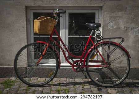 Bicycle  by window in a Copenhagen side street - stock photo